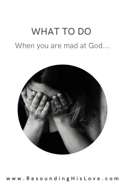 an image of a woman clasping her hands to her face crying with text Shattered: Mad at God
