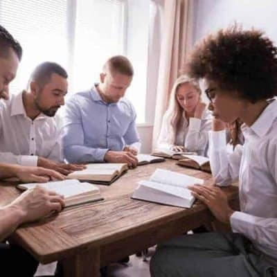 an image of a small group doing a bible study together featured image
