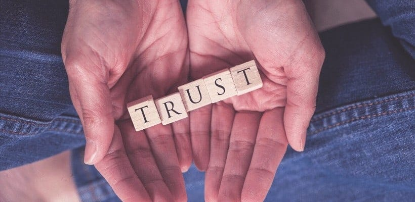 an image of a hand hold blocks that spell trust featured image for Are You Trusting God in Times of Uncertainty?
