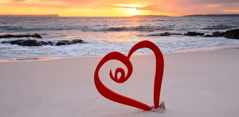 an image of a heart made in the sand featured image for What Does Loving God with All Your Heart Look Like?