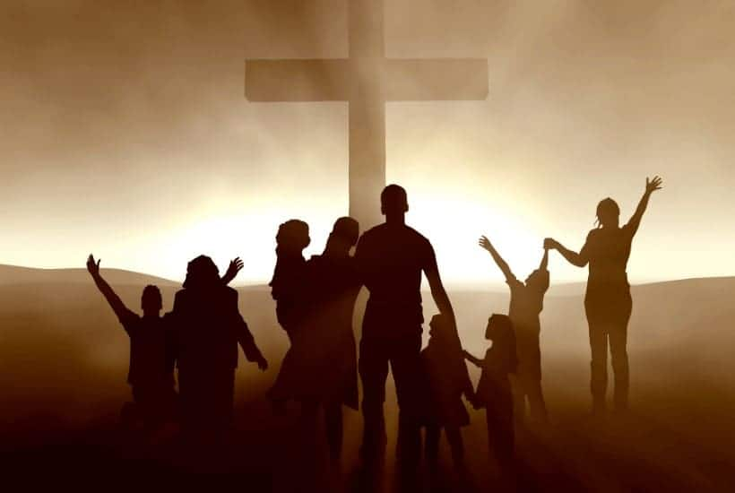 an image of people praising God surrounding a cross featured image for Why We Need a Spiritual Revival Today More than Ever