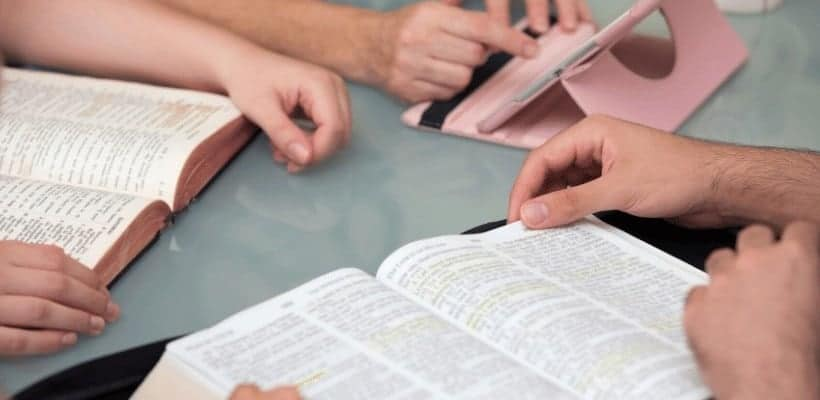 an image of several open bibles on a table for bible study featured image for What Does the Bible Say About Our Identity in Christ?
