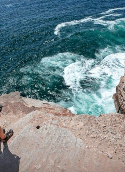 an image of a woman overlooking a cliff featured image for10 Best Ways to Trust God in All Circumstances