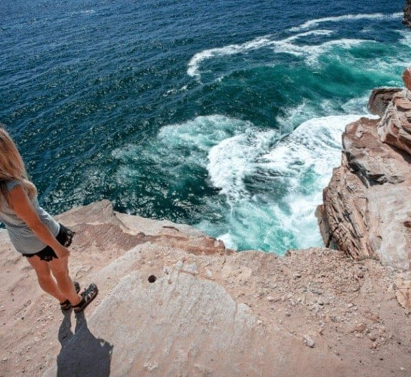 an image of a woman overlooking a cliff featured image for How To Go About Trusting God in All Circumstances No Matter What