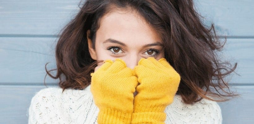 an image of a woman wearing a white sweater with yellow gloves while she's grasping her face with her hands with text reading Grasping God Given Opportunities to Connect with God