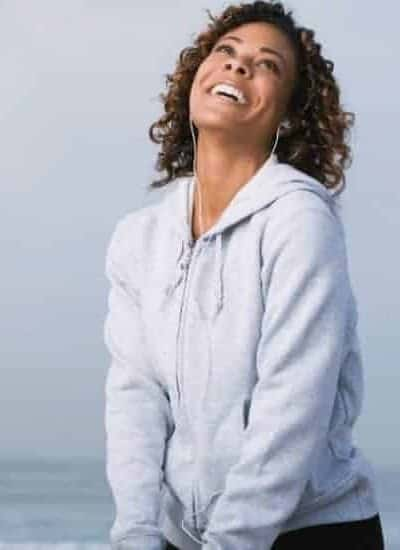 an image of a woman smiling looking towards the sky with text reading 30 Ways to Be Complete in Christ