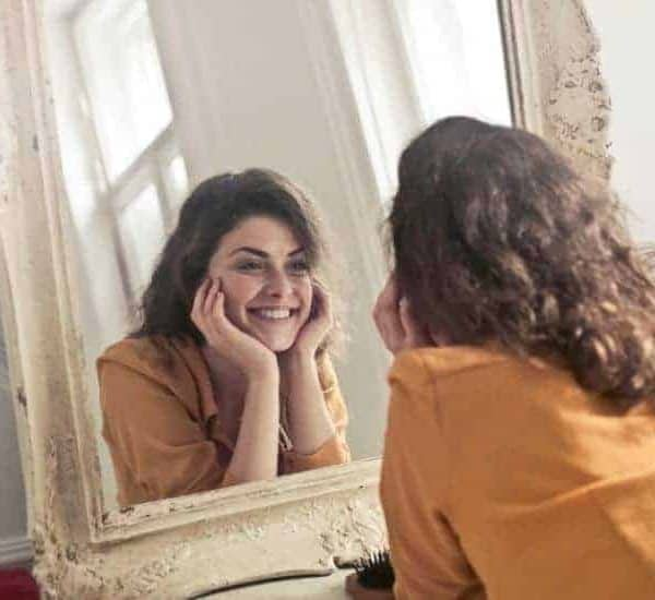 an image of a woman looking at her reflection in a mirror