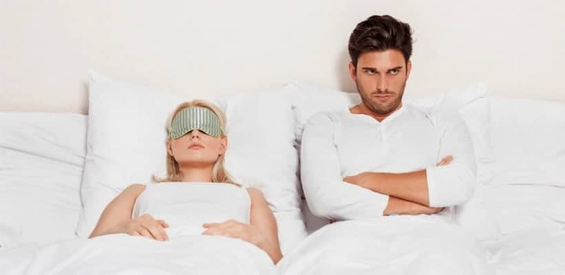 an image of husband and I wife ignoring one another with text reading What Does the Bible Say about Forgiveness?