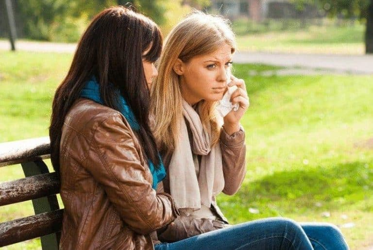 an image of two women sitting on a park bench featured image for 7 Helpful Ways to Find Healing from Abuse