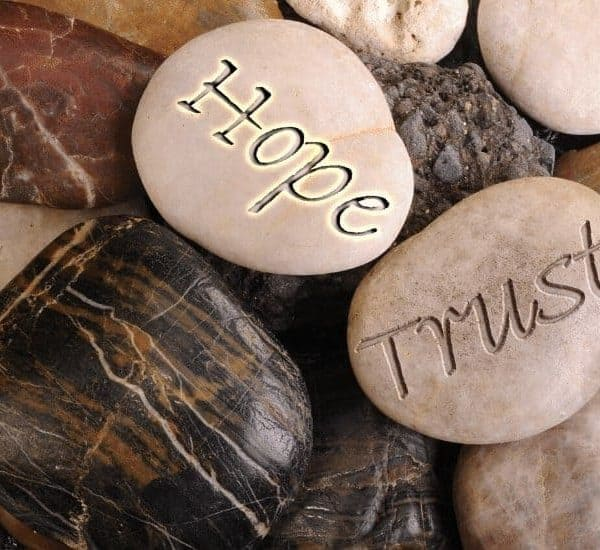 an image of rocks that have hope, trust, and faith written on them