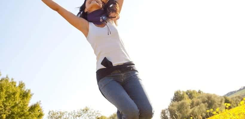 an image of a woman in a filed jumping in the air text reading 7 Tips to Living a Transparent Life for Christ