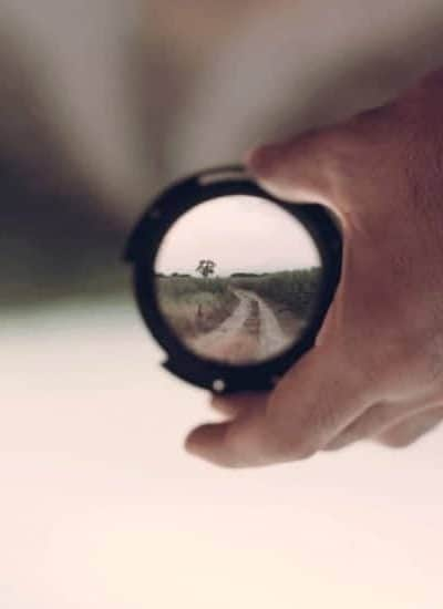 an image of a man holding a small compact mirror facing towards us. featured image for 4 Simple Ways to Let Them See Jesus in Me and You!
