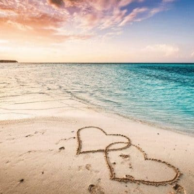 an image of a beach scene to two hearts carved in the sand featured image for God Knows the Intent of Your Heart: Guard Your Heart
