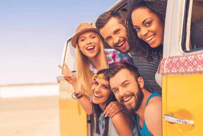 an image of a group of friends hanging out the side door of a van featured image for Godly Friendships: What Does the Bible Say About Godly Friendships?What Does the Bible Say About Godly Friendships?