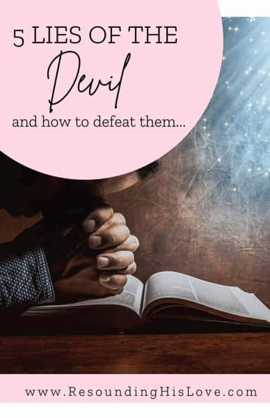 a woman with her bible open praying with her hands folded on the bible with text 5 Lies of the Devil and How to Defeat Them