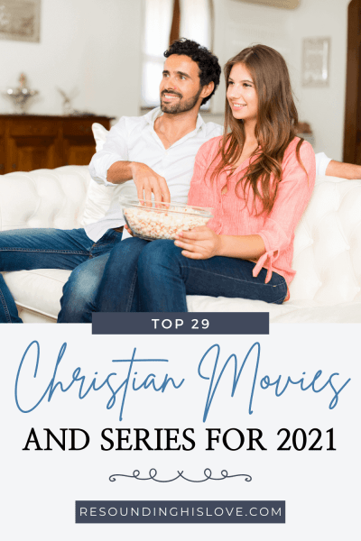 a man and woman sitting on a white couch eating a bowl of popcorn and watching TV with text The Best Christian Movies and Series for 2021
