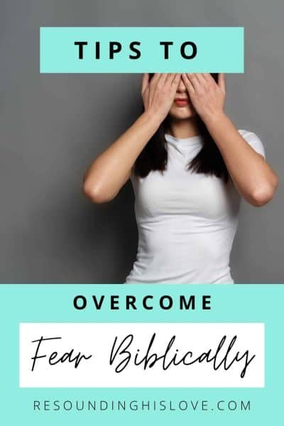a woman wearing a white shirt with her hands over her eyes with text Tips to Overcome Fear Biblically in 10 Action Steps
