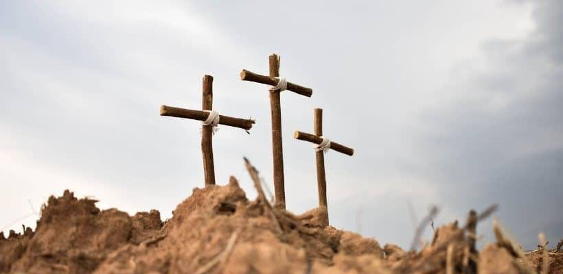 3 wooden crosses in a field featured image for What Does the Death of Jesus on the Cross Mean for You?